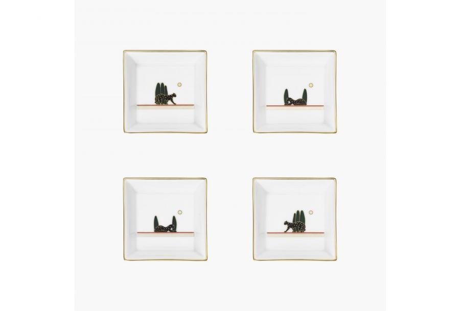 Набор из четырех подставок для мелких предметов Panthère de Cartier, маленькая модель   https://www.vogue.ru/